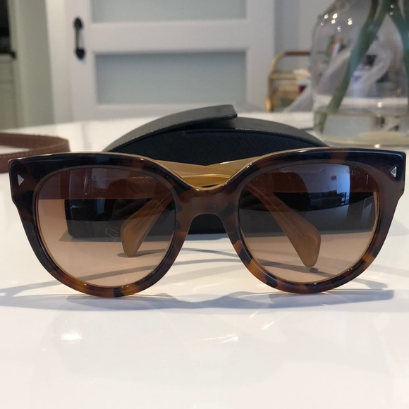73db08cc6 Prada 54mm Cat Eye Sunglasses in Tortoise. M_5a81cd153a112e5adf2b6732